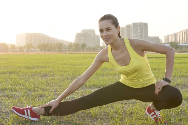 Woman stretching before jogging