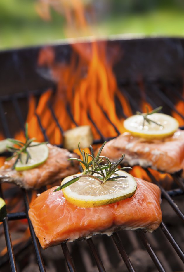 Three grilled salmon fillets on a BBQ