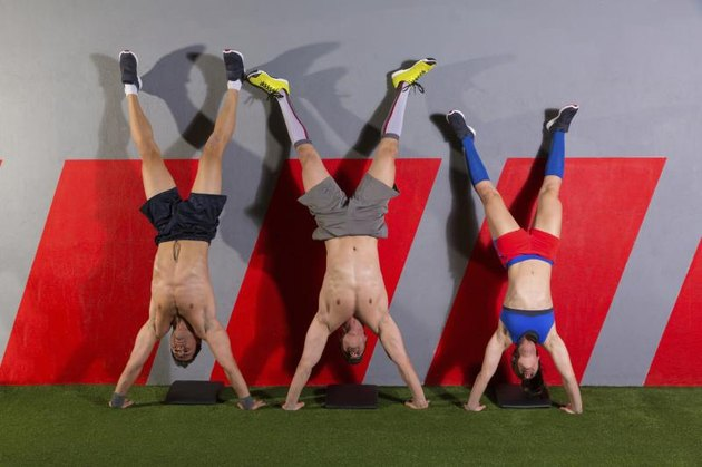Handstand push-up group pushups workout top position at gym