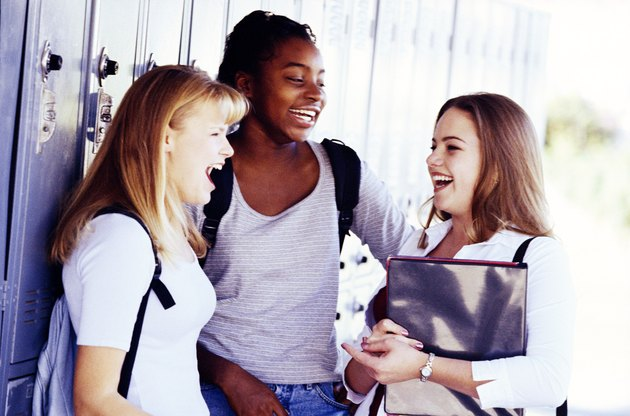 Teenage girls by lockers