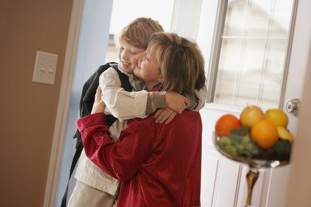 Mother hugs child good-bye