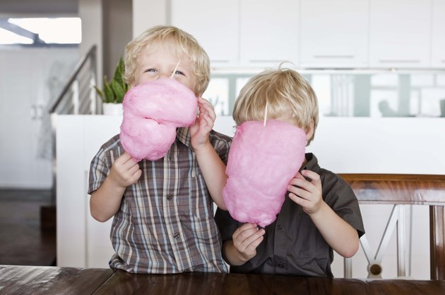 Twin boys with cotton candy
