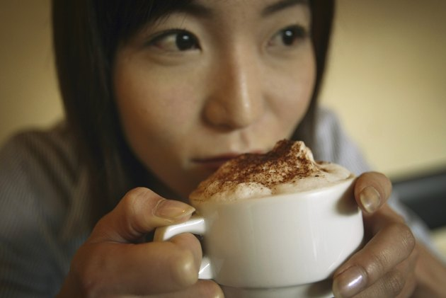 Young Adult Woman Drinking a Coffee