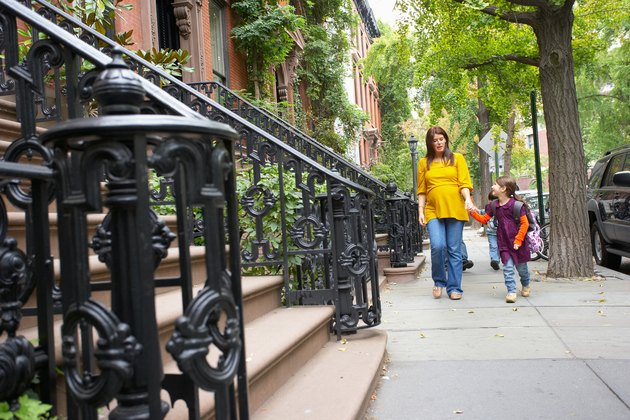 Mother and daughter walking in neighborhood, Manhattan, New York City