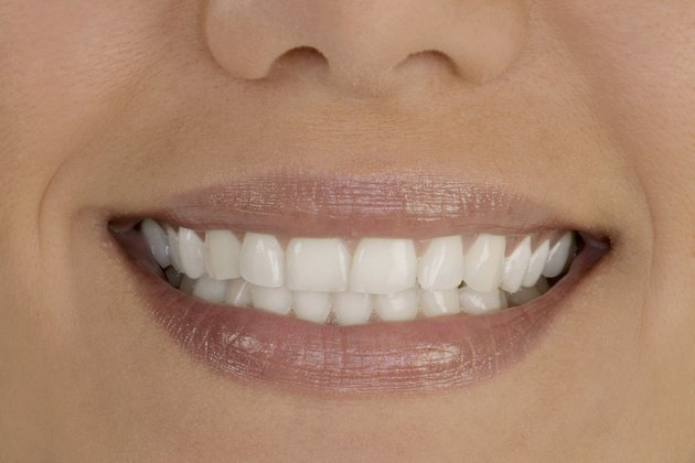 Extreme close-up of young woman's smile