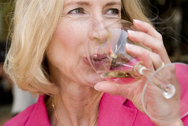 Close-up of mature woman drinking wine