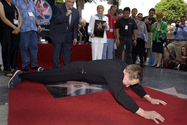 HOLLYWOOD - SEPTEMBER 26:  Physical fitness expert Jack LaLanne does push-ups over his new star on the Hollywood Walk of Fame on September 26, 2002 in Hollywood, California.  (Photo by Vince Bucci/Getty Images)
