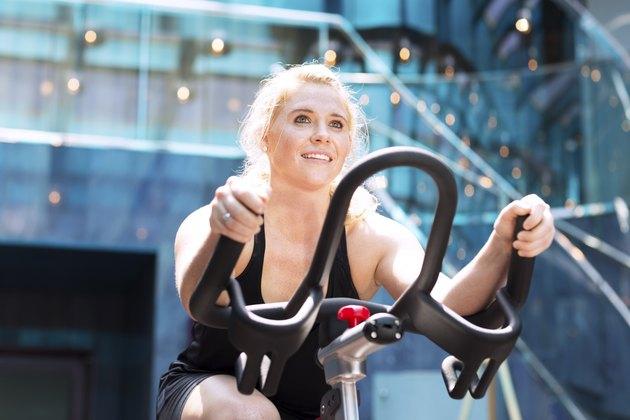 Girl driving stationary bik