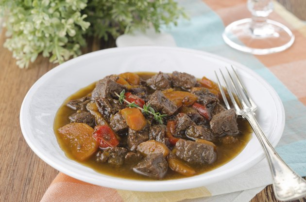 stew of beef with vegetables and prunes in a plate