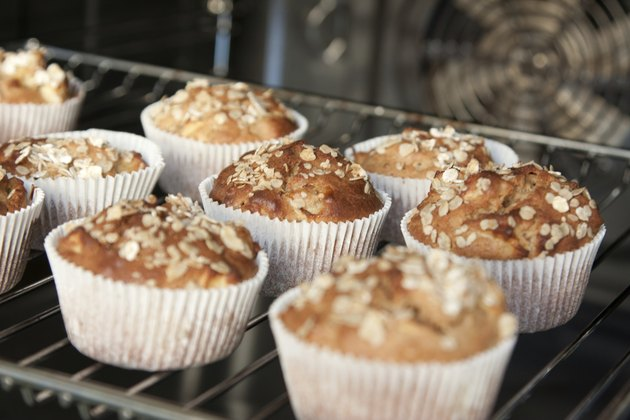 Freshly baked apple muffins with oat flakes