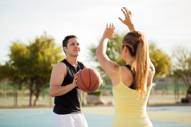 Cute couple playing basketball