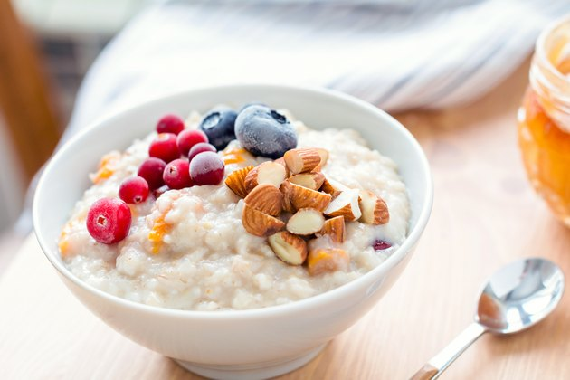 Oatmeal porridge with berries and nuts in bowl