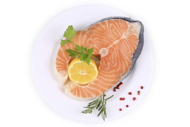 Fresh salmon steak with lemon and pepper.