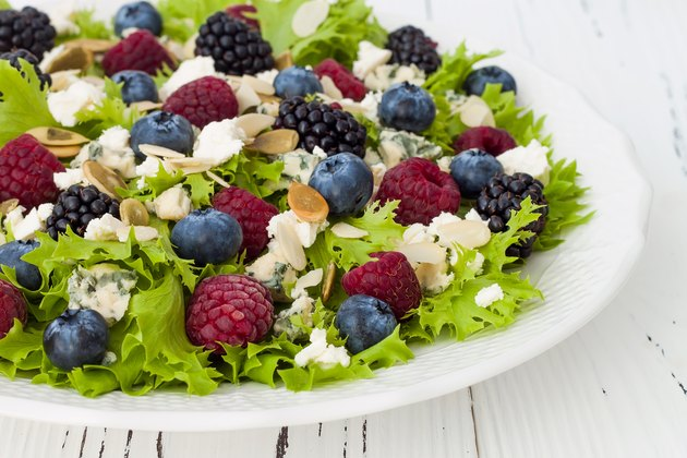 Green mixed berry salad with seeds, blue cheese and almonds