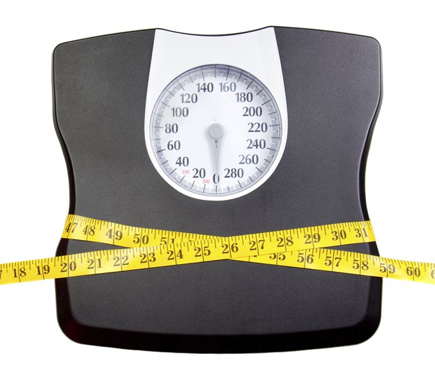 Bathroom scale with a measuring tape