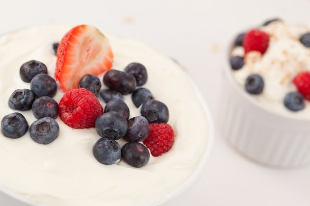 Bowl of cream with different berries