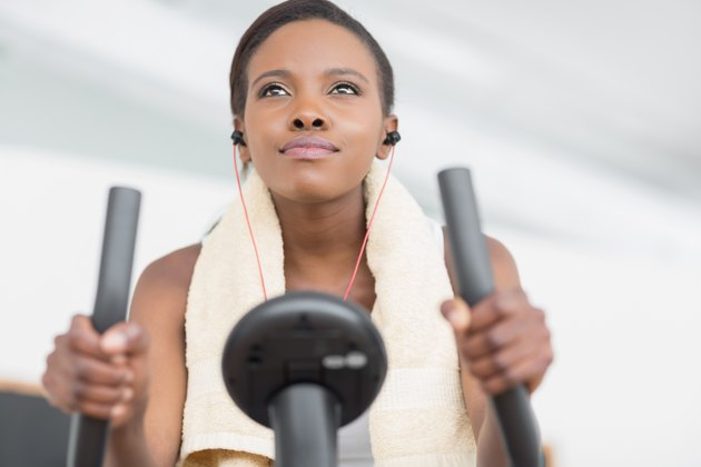 Low angle view of a black woman doing exercise bike