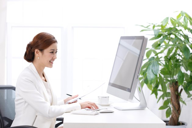 Young business lady using computer