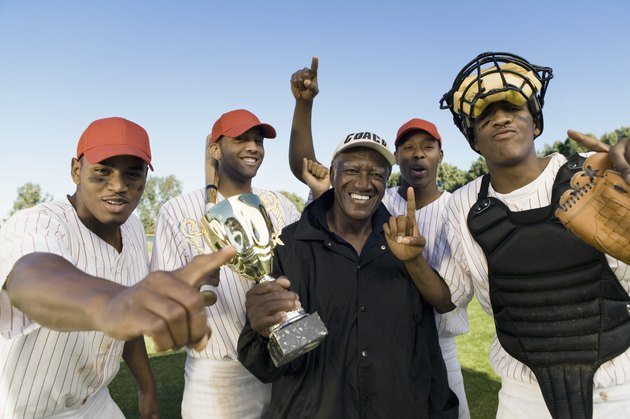 Baseball Team And Coach With Trophy Celebrating Victory