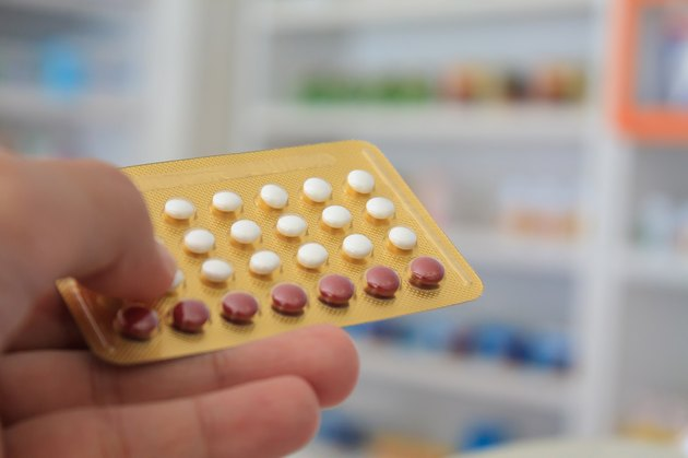 Close up of pharmacist hands holding contraceptive pills
