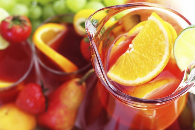 Refreshment beverage in pitcher with fruits