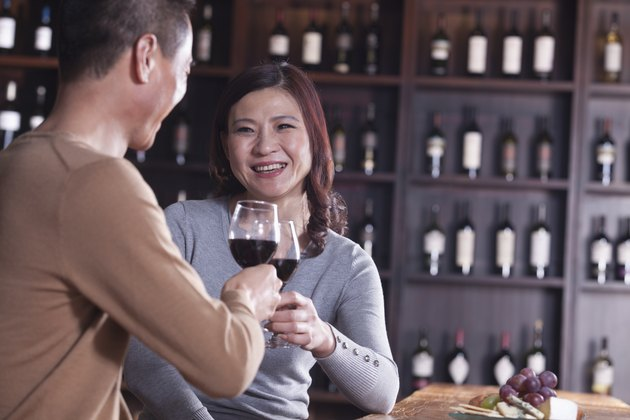 Mature Couple Toasting and Enjoying Themselves Drinking Wine, Focus on Female