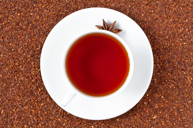 White cup of red rooibos South African tea with star