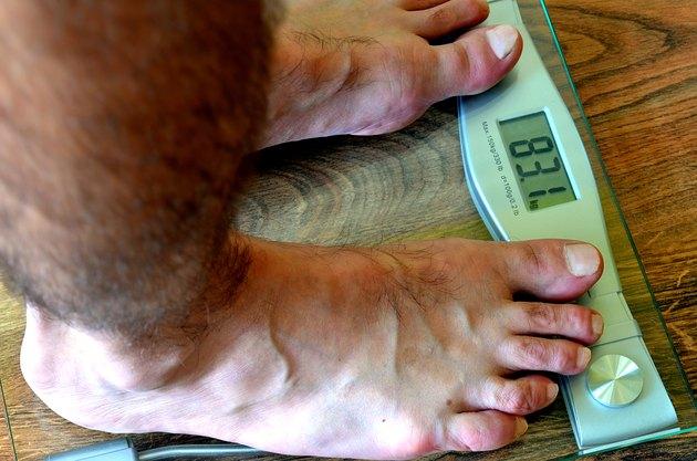 Man standing on weighing-machine