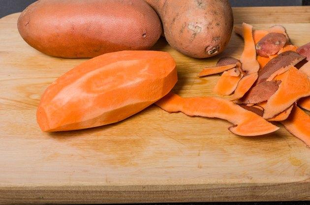 Sweet potaoes peeled on cutting board
