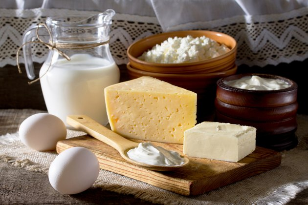 Homemade dairy products and eggs on a wooden table.