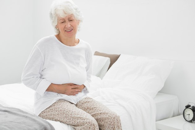 Old woman suffering with belly pain
