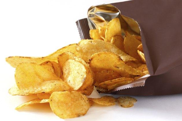 Open packet of crisps on white