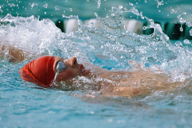 Person swimming laps  doing backstroke