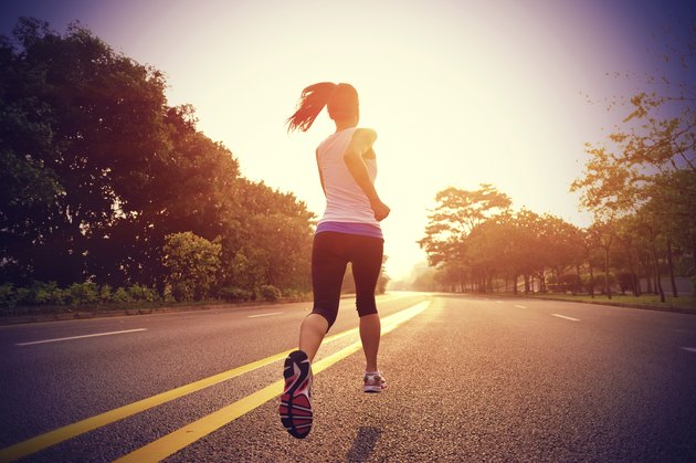 healthy lifestyle fitness sports woman  running on road