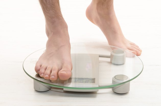 standing on scales
