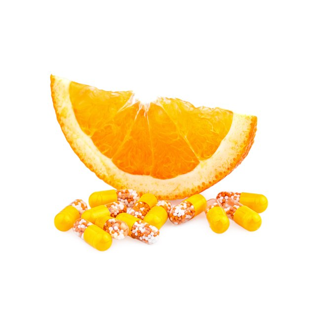 Vitamin pills and Orange Fruit