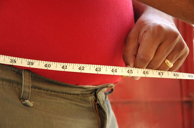 A person measuring waist, Side view
