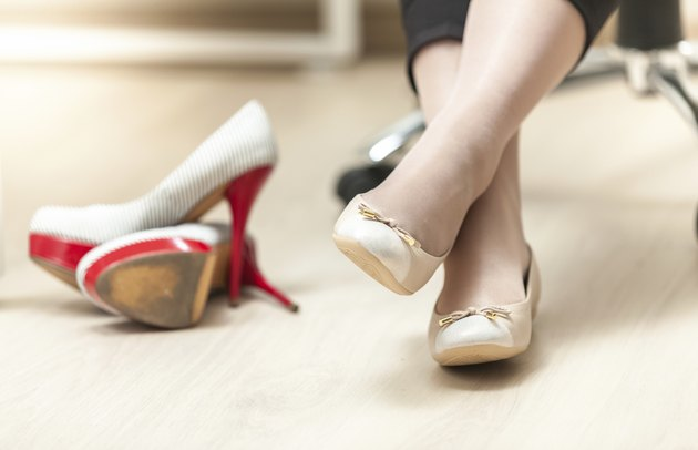photo of woman wearing ballet flats instead of high heels