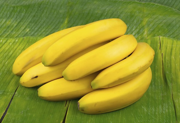 perfect yellow bananas on a banana leaf
