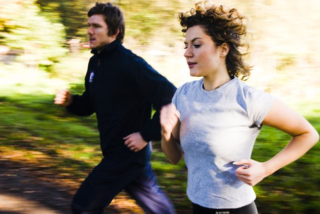 Young couple jogging in a park
