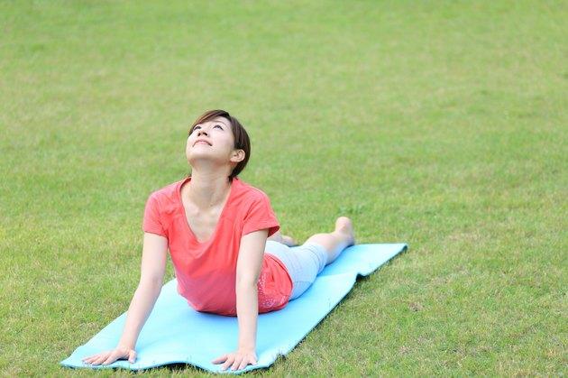 Japanese woman doing yoga Cobra Pose