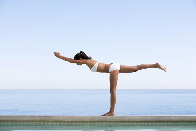 A young woman practicing yoga