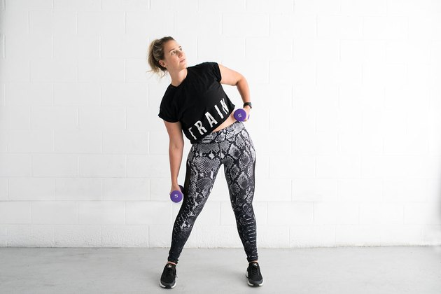 woman doing standing side bend ab exercise