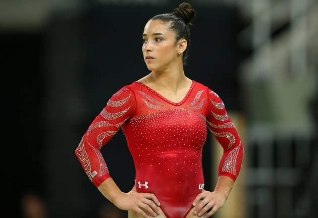 Aly Raisman waits during gymnastic competition.