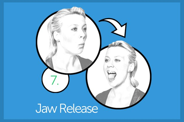 Woman performing jaw release exercise.