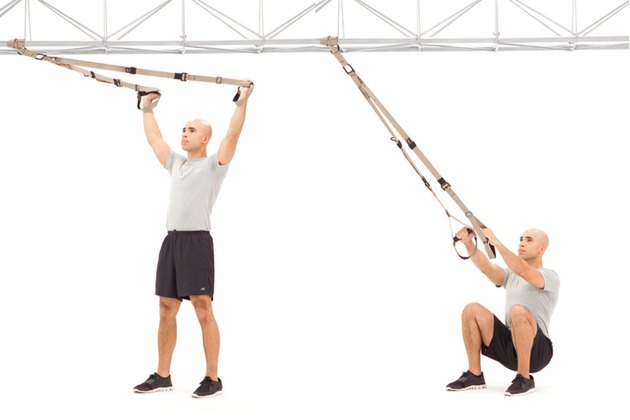 Man doing Squat Y Fly on the TRX Suspension Trainer