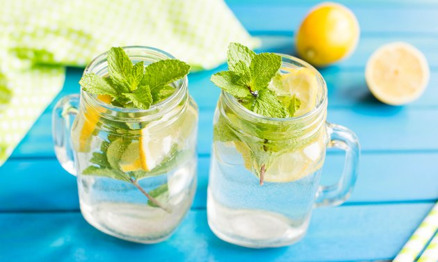 Two mason jars with water and lemon.