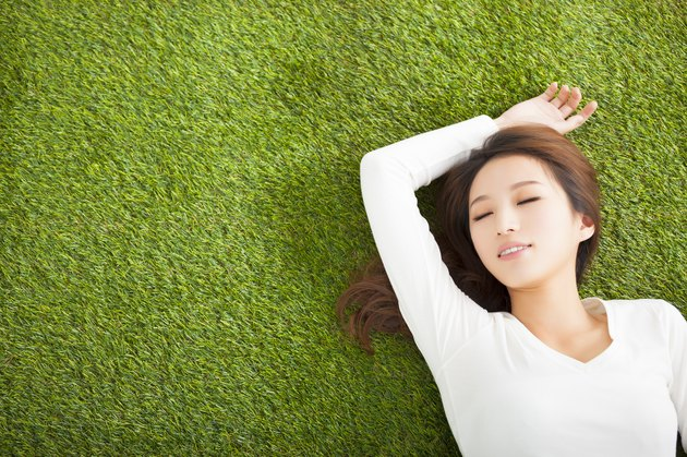 Relaxed woman laying on the grass.