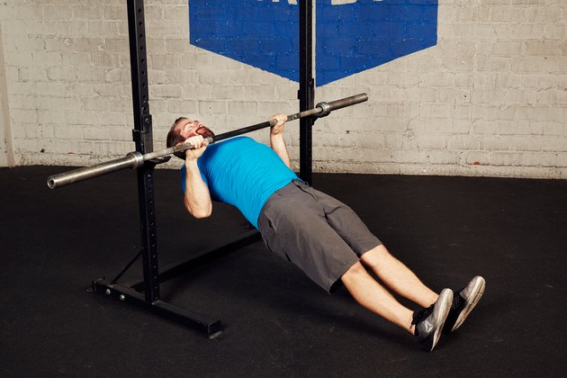 man doing inverted row