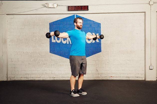 man doing dumbbell lateral raise